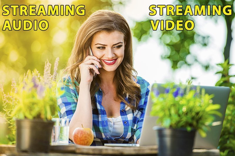 Woman Streaming Audio and Streaming Video course from her laptop